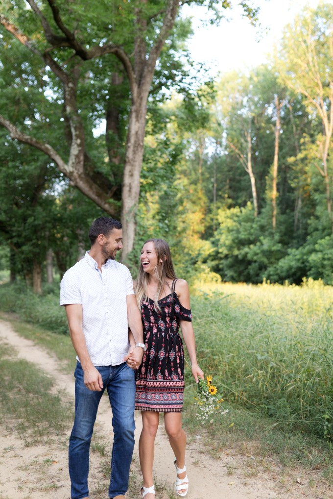 Dasha and Valentin laugh and bump hips during their couple portrait photo shoot. Elizabeth A. Images