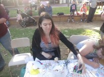 Brianna at the CHO table (what would we have done without her!)
