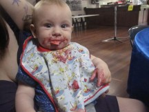 Jack at the party getting stuck into his great-auntie's beetroot dip