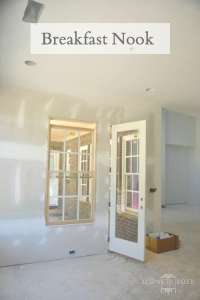 unfinished drywall in breakfast nook leading to back porch