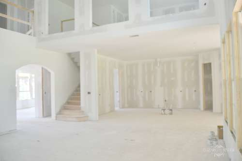 Unfinished Living and Kitchen with drywall,lighting, and plumbing in an open floor plan