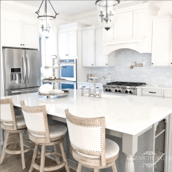 white cabinets, grey kitchen island, quartz countertops