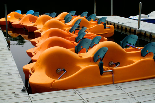 Bright orange boats at pier