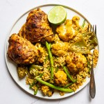Roast Chicken Tikka Masala with vegetables and rice on a plate with a fork