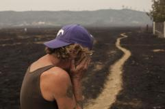 Robert Hooper, exhausted after several days with little sleep, is overcome with emotion while surveying his property that was burnt by the Valley Fire near Middleton.