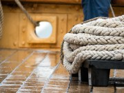 More mooring lines, and a wet deck gleaming.