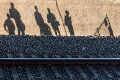 Shadow people waiting for the train.
