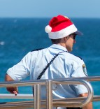 The ever-stylish red Santa hat is part of the uniform today.