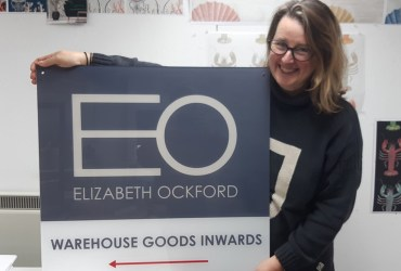 Elizabeth-with-goods-inwards-sign