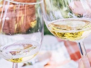 Wines for a celebration: two glasses of white wine clinking