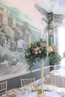 Candelabra flowers and KWH mural- Elizabeth Weddings