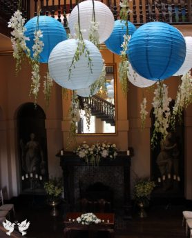 Hanging lanterns in the Great Hall- Elizabeth Weddings