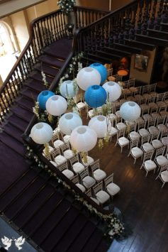 Hanging lanterns in the ceremony room- Elizabeth Weddings