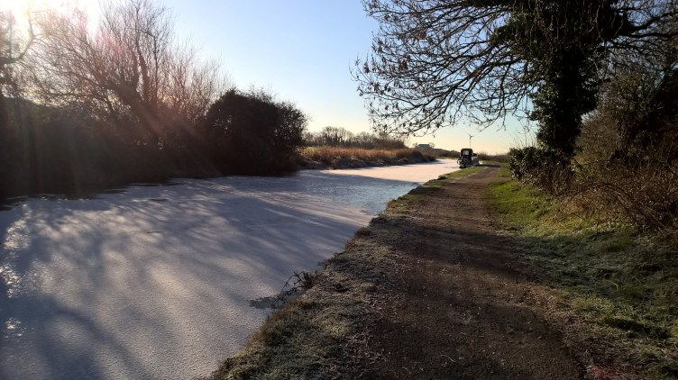 How to Winter on a narrowboat? Frozen Lancaster canal at sunset.