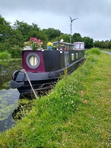 Wind turbines and narrow boats- A wind turbine erected upon a narrow boat roof.