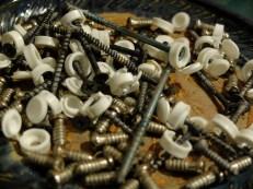 Screw by screw.