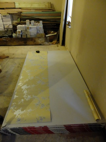 Find a long, flat clean surface to unroll the paper. For us this was one of the most challenging steps because of the current landscape at Amber Lane. Fortunately those 11 sheets of drywall came in handy!