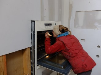 """""""Fixing"""" the oven... with a spoon."""