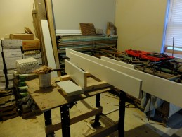 The baseboards in the first of THREE colors. Yes, we changed our minds 3 times about the color of the molding. White (too boring)... burgendy (too patriotic)... evening hush (the safe standard!)