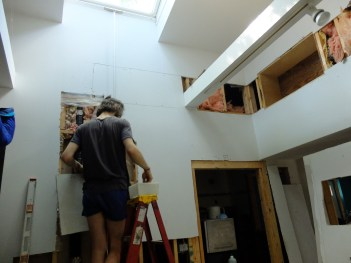 The cubby is In. Emme is Out. Fitz repairs drywall.