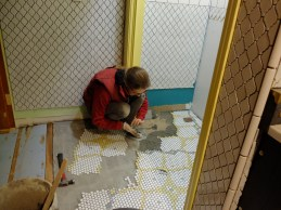Long ago I did away with the dry setting of the tiles. Now I just built little blurbs of the pattern next to me and thin set them in as I went.