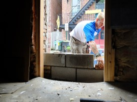 Our mason beginning to brick up the door opening.