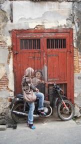 ~Street art, Penang...Boy on his old motorcycle..