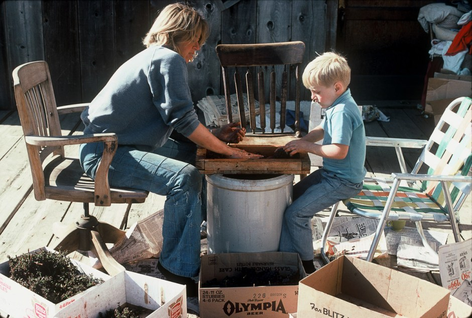 Pat Campbell and son Adam crushing grapes by hand in 1977