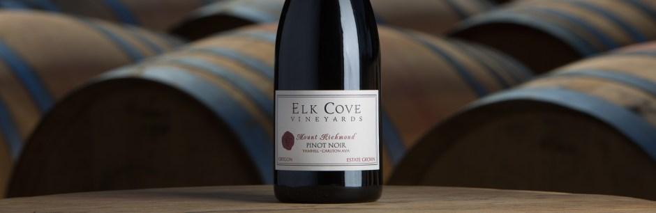 Pinot Noir bottle on barrel