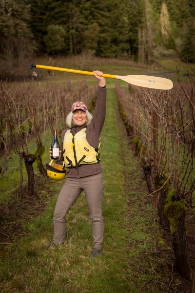 Shirley with a paddle and a bottle of wine