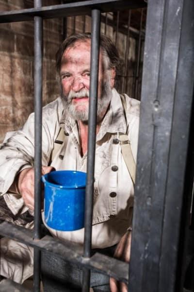 Image of old prisoner in jail