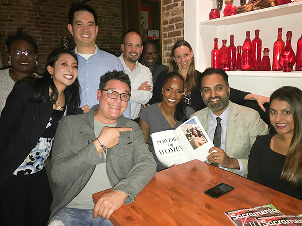 """Tracie Stafford, pictured with Amar Shergill, Parveen Tumbler, Gina Barkalow, Fabrizio Sasso, Robert Longer, Jacqueline """"Jax"""" Cheung, Kenneth Cheung, and several others"""