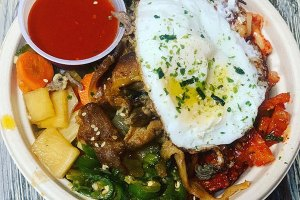 Fire Mix Bowl with Spicy Pork (I added Bulgogi), kimchi, miso peppers, mixed veggies, cucumber kimchi, with gochujang sauce and a fried egg over white rice