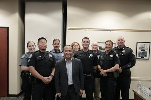 Mayor Steve Ly with officers of the Elk Grove Police Department