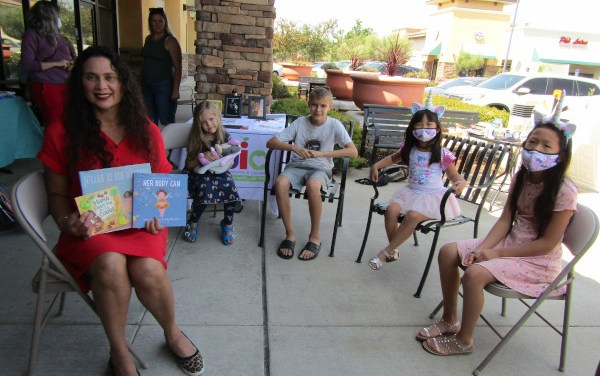 Mayor Bobbie Singh-Allen Reads To Kids At A Seat At The Table Books Pop-Up
