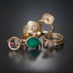 assorted gold rings, diamonds, rubies, emerald.