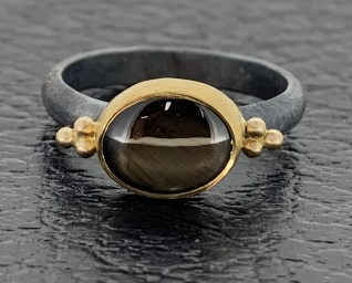 Black star sapphire, 22k gold and oxidized sterling