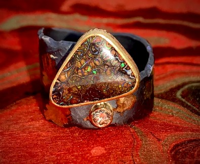 Boulder opal in 22k gold, oxidized sterling with diamond