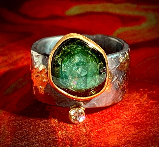 Thick cut natural tourmaline slice in 22k gold with diamond, oxidized sterling and 14k gold