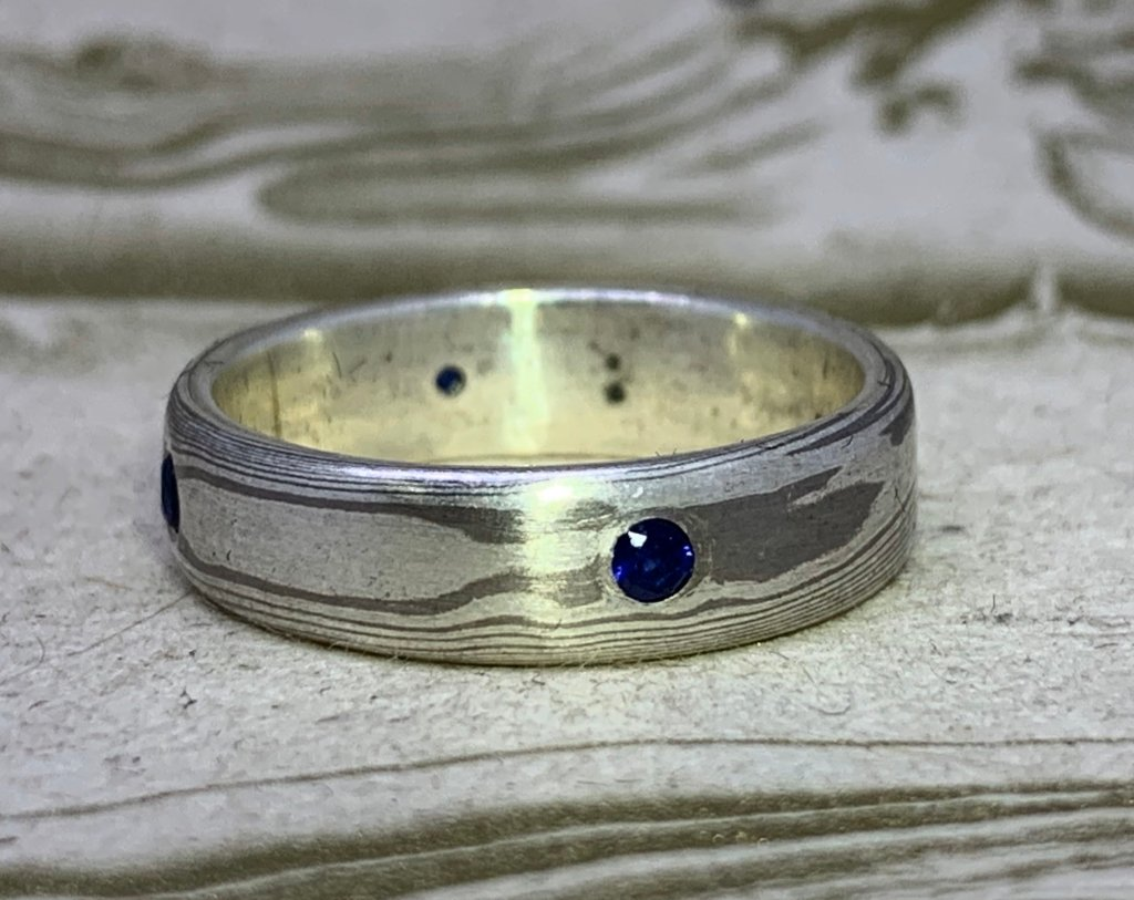 Mokume Gane Band -with blue sapphires, 14k palladium white gold and sterling