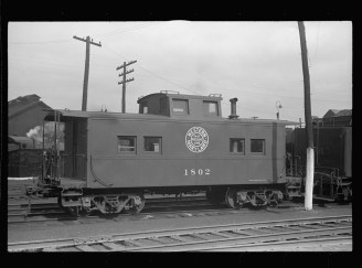 Caboose in railroad yards. Elkins, West Virginia. Photo by John Vachon, from the Library of Congress.