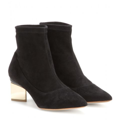 """These Nicholas Kirkwood ankle boots are the perfect shoe for any outfit. Whether you pair them with an office-appropriate midi skirt or casual black skinny jean, they offer comfort and style for every occasion."" Nicholas Kirkwood Suede Ankle Boots, $854; mytheresa.com"