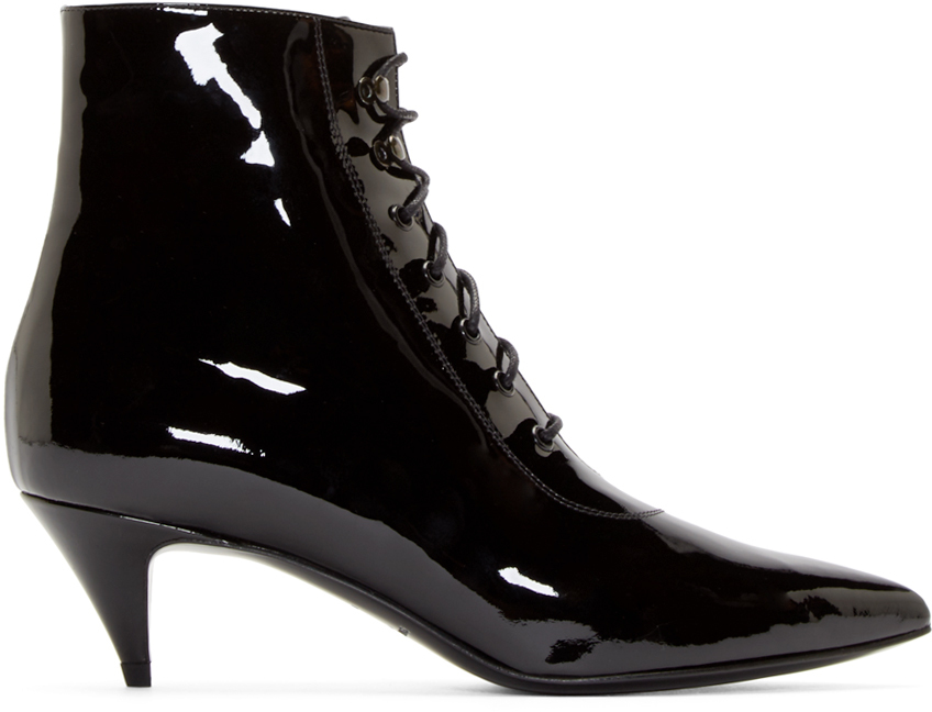 """I can run around day after day and still not get tired of these Saint Laurent boots. They are super comfortable, on trend with the pointy toe, and because they are patent leather, very easy to clean."" Saint Laurent Black Patent Cat Ankle Boot, $845; ssense.com"