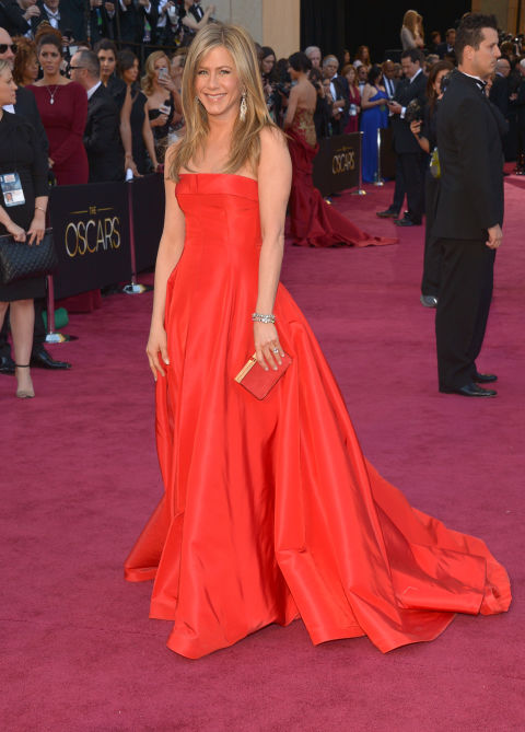 Toning down her Valentino gown with girl-next-door hair for the Oscars. This is a seminal Jennifer Aniston look.