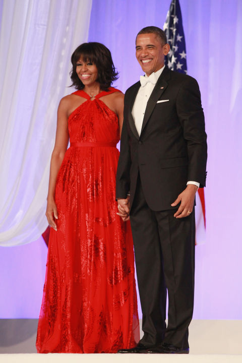 "The first lady made a bold move by wearing the same designer for her second inaugural ball as she did for the first (Jason Wu). The second time around, she chose a standout shade of  ""victory red"" that's carved a spot out in our memory for good."