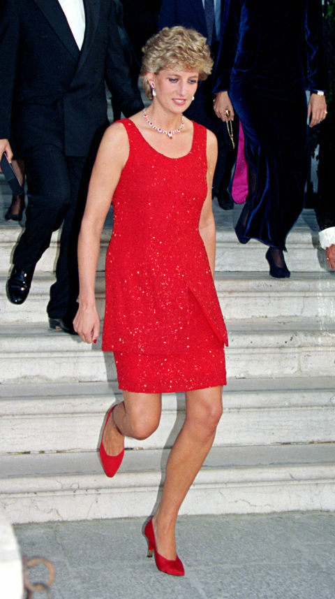 While married to Charles, Diana was supposed to wear British designers exclusively. But post-separation from Charles in 1992, she wore Italian labels like Versace and French designs, too—like this red dress by Christian Lacroix. (Note the perfectly matched shoes.)