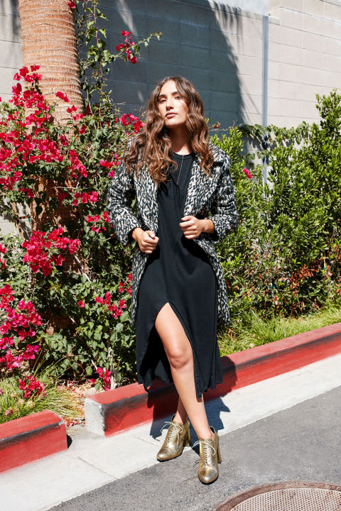 A printed coat with a dramatic collar draws attention upward,an instant optical illusion that boosts stature for smaller frames. Keep it unbuttonedfor an uninterrupted vertical line of vision, and add a neutral shoe for a final lengthening touch. Rebecca Minkoff Luke Leopard Print Wool Blend Coat, $448, nordstrom.com; Bottega Veneta Metallic Side-Zip 85mm Bootie, $740, neimanmarcus.com; Forever21 Bar Pendant Drop Necklace, $4.90, forever21.com; Simple Ring Pack, $18, urbanoutfitters.com