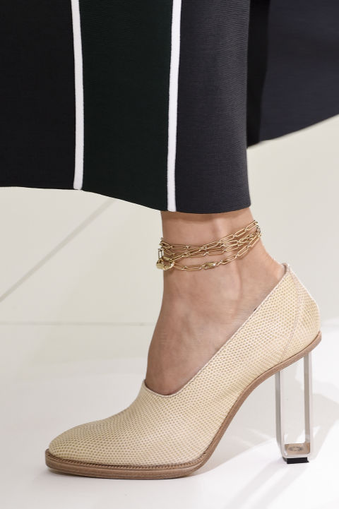 Don't neglect your feet this season. Apply Hermes' anklet bracelet trick: Instead of a dainty chain, they wrapped a necklace multiple times around for this chunky, layered look.