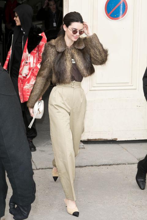 Leavingthe CHANEL Paris Fashion Week show in France.