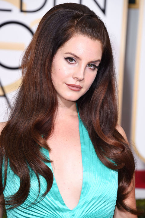 Lana Del Rey's chestnut has highlights in cool-toned auburn-red.